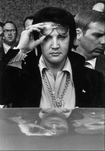 (Copyright: Dave Darnell / The Commercial Appeal)Elvis Presley is reflected in the roof of his automobile as he looks into the camera after attending a luncheon January 16, 1971 at what was then the Holiday Inn Rivermont. The luncheon was part of the festivites surrounding his being named one of the Jaycees of America's Ten Outstanding Young Men in America.   (By Dave Darnell / The Commercial Appeal)