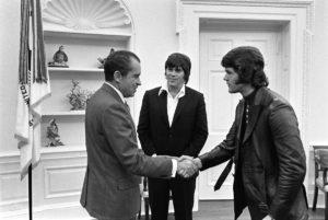 5369-12A:  The President greets Elvises' associates